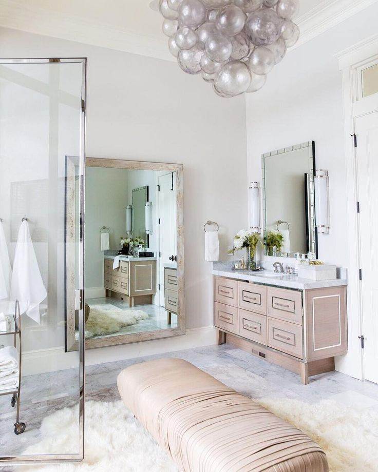 Wishing we could get ready in this master bath everyday! The soft pinks and that fur rug are so inviting, no?  photo by @lindsay_salzar_photography...For questions about any specific piece in this room or for any design service needs, feel free to contact our design center at designrequests@alicelanehome.com   #Regram via @alicelanehome