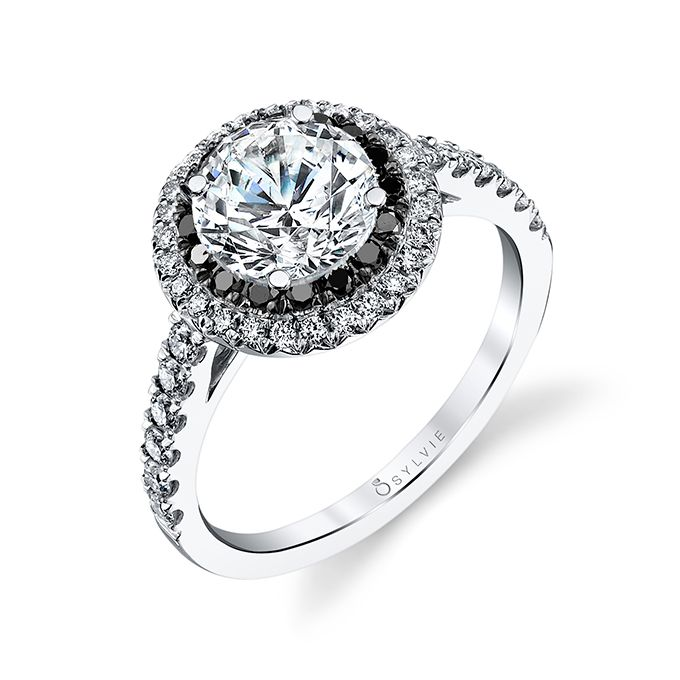 Brides.com: 99 Gorgeous Engagement Rings for $5,000 or Less Diamond engagement ring with 3/4ct round brilliant center with 0.51 carats of white and black diamonds set in 14k white gold, $4,310, Sylvie CollectionPhoto: Courtesy of Sylvie Collection