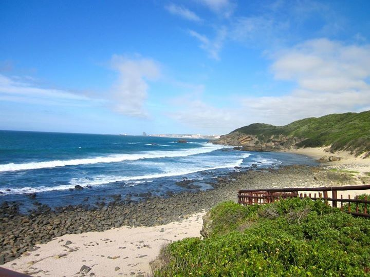 Nahoon Beach, East London, South Africa. Nahoon beach is East London's best surfing beach. From the road you walk through a sandy path with dense trees and vegetation winding down to Nahoon's golden beach and shoreline. Put this on your bucket list.