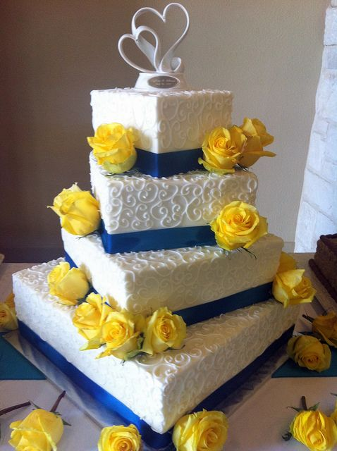 Four Tier White Offset Rectangular Wedding Cake With Blue Bands And Yellow Roses Change To Gray