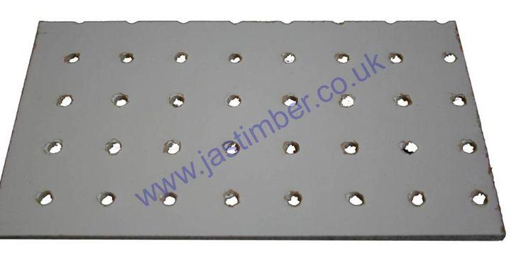 White Perforated Hardboard - White Pegboard Cut Size 3.0mm - 19mm hole centres @ JAS Timber Merchants Blackburn Lancashire North-West UK.