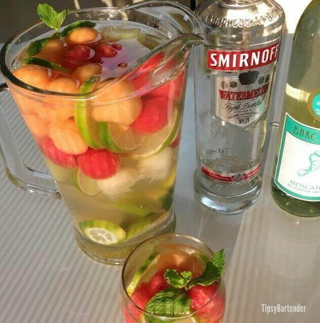 VODKA MELON SANGRIA  1 Cup Watermelon Balls 1 Cup Cantaloupe Balls 1 Cup Honeydew Balls 3 oz. (90ml) Watermelon Vodka 1/2 oz. (15ml) Agave 1 (750ml) Bottle Moscato 2 Limes Mint Sprigs