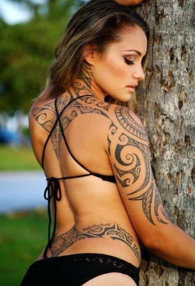 Tribal tattoo on woman – sleeve, hip, upper back