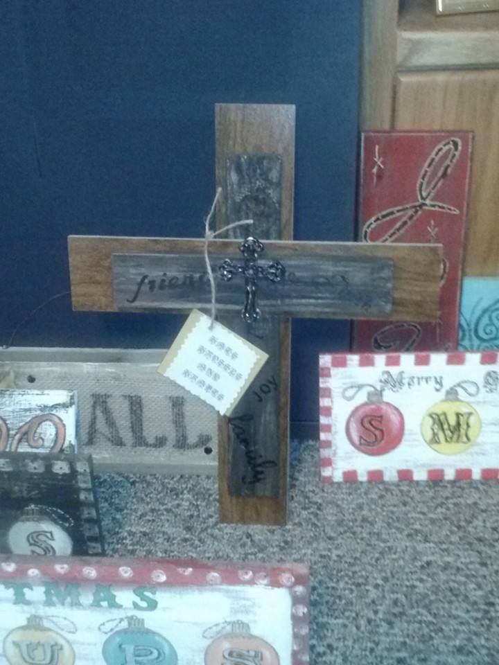 This was made for a charity auction...Made from laminate flooring, old fence with a metal cross for centerpiece...words are written all over the old fence part...
