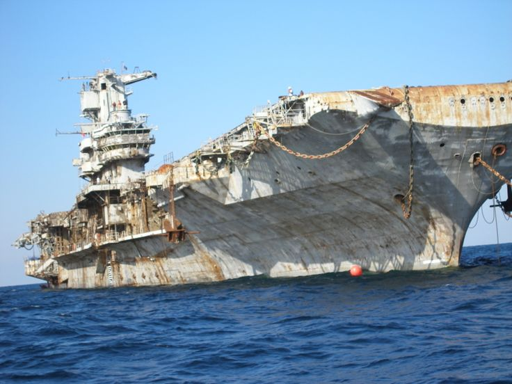 """The majestic USS """"Oriskany"""" - a giant abandoned aircraft carrier - has become a real treasure for diving adventurers and tour operators.  Brought 22 miles off shore and sunk there in 2006, its gutted remains may have served as a powerful inspiration.It certainly looks like something that could loom out of the time vortex, in the mist somewhere...."""