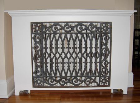 Architectural antiques iron grille incorporated into modern radiator cover