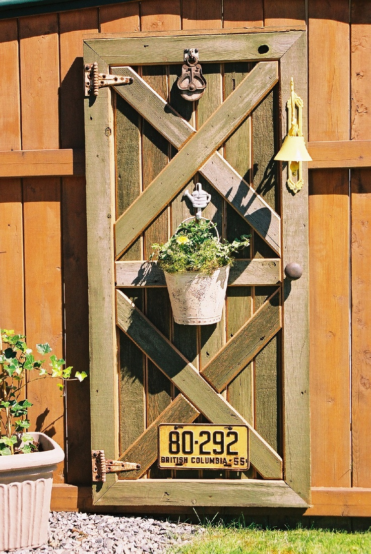 Custom barn door fence decor with plant hanger old hinges for Barn door design ideas