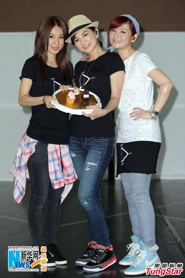 "Members of the pop group S.H.E celebrate the birthday of Ella (C) during the final rehearsal for their ""2GETHER 4EVER"" World Tour 2013 in Taipei, Taiwan, June 18, 2013. The concert will be held at the Taipei Arena on June 22-23."