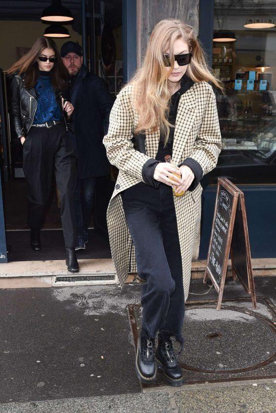 Gigi Hadid wearing Dr. Martens Lazy Oaf Jungle Boots, DL1961 Hepburn High Rise Wide Leg Jeans in Savannah Destroy, Ambush Spring 2018 Check Long Coat and Tommy Hilfiger X Gigi Racer Sunglasses
