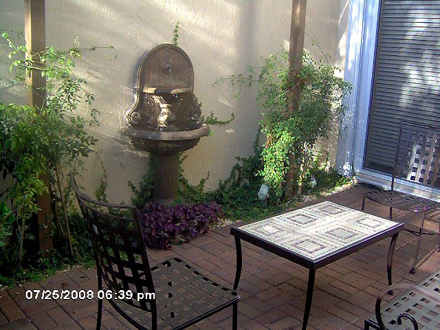Tuscan Courtyard  wall fountain in courtyard  Courtyard