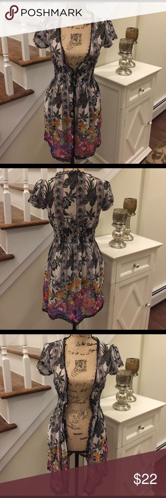 🌻🍄 AMERICAN RAG 🍄🌻 Gorgeous Cover Up 🌻🍄 AMERICAN RAG 🍄🌻 Gorgeous Cover Up this great over a bikini or with a tank top, jeans or capris.  The Flowers on the bottom just dress up anything yours wearing.  Preloved in great condition. American Rag Tops