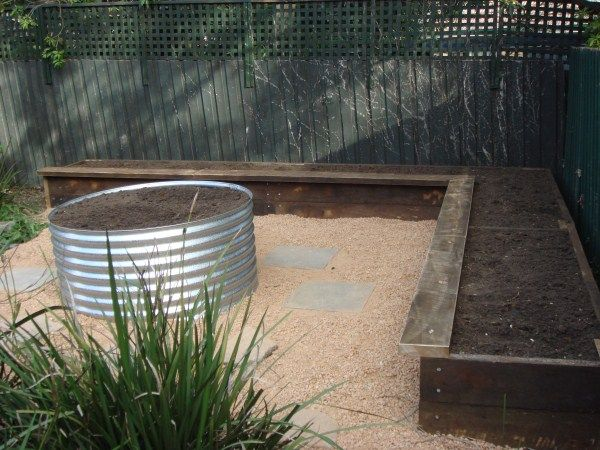 Ironbark L-shaped bed with earth ring designed & built by Yummy Gardens, Melbourne