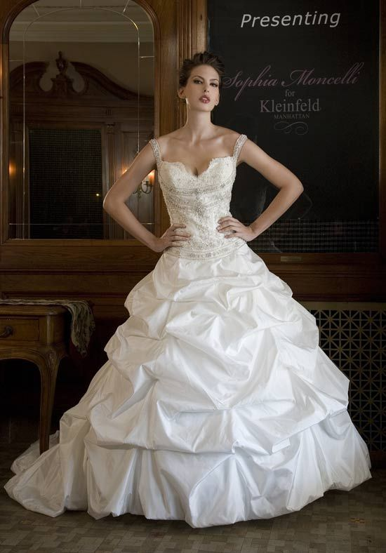 Gown features beading, embroidery, and pick-ups.