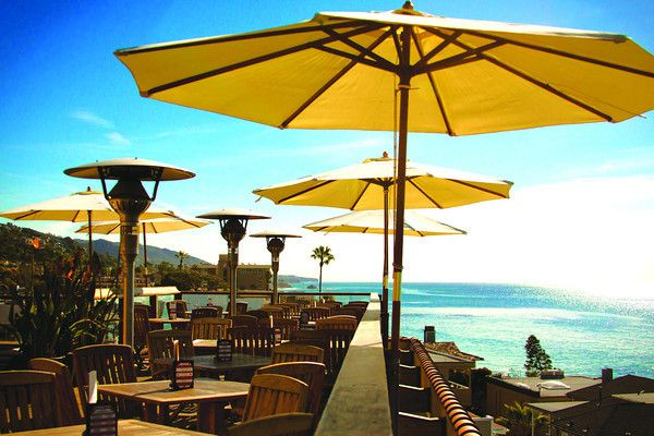 The Rooftop Lounge, sits atop Hotel La Casa del Camino- world famous mojitos that are hand muddled with fresh fruit, ocean views and the best sunsets in Laguna Beach! #LagunaBeach #Vacation #cocktails #ocean #sunsets #relax