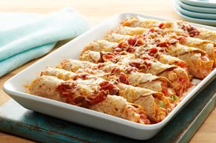 "Fiesta Chicken Enchiladas Made Over looks good. Hard to believe it is ""healthy""."