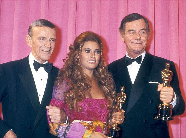 Image: 1970: Fred Astaire, Raquel Welch and Gig Young attend 42nd Annual Academy Awards on April 7, 1970 at the Dorothy Chandler Pavilion ..wish I could see the rest of Raquel's Academy Award's dress