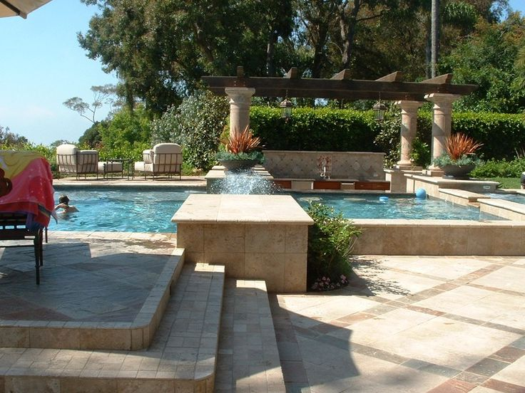 Raised deck area and column travertine coping steps and for Raised pool ideas