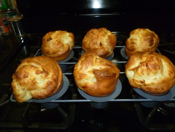 Gordon Ramsays Yorkshire Pudding Recipe- Oven to 425.  Oil in pans- almost smoking.  Pour in batter- bake 15-20 min.  DO NOT OPEN DOOR or they will collapse.
