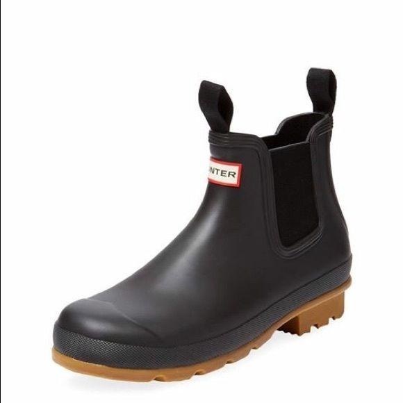 NIB- Hunter Men's Original Pull tab Chelsea Boot New in Box. Color: Black. Authentic Hunter Men's Original pull tab Chelsea boot. $145 plus tax. Perfect rain boot for men! Hunter Boots Shoes Winter & Rain Boots