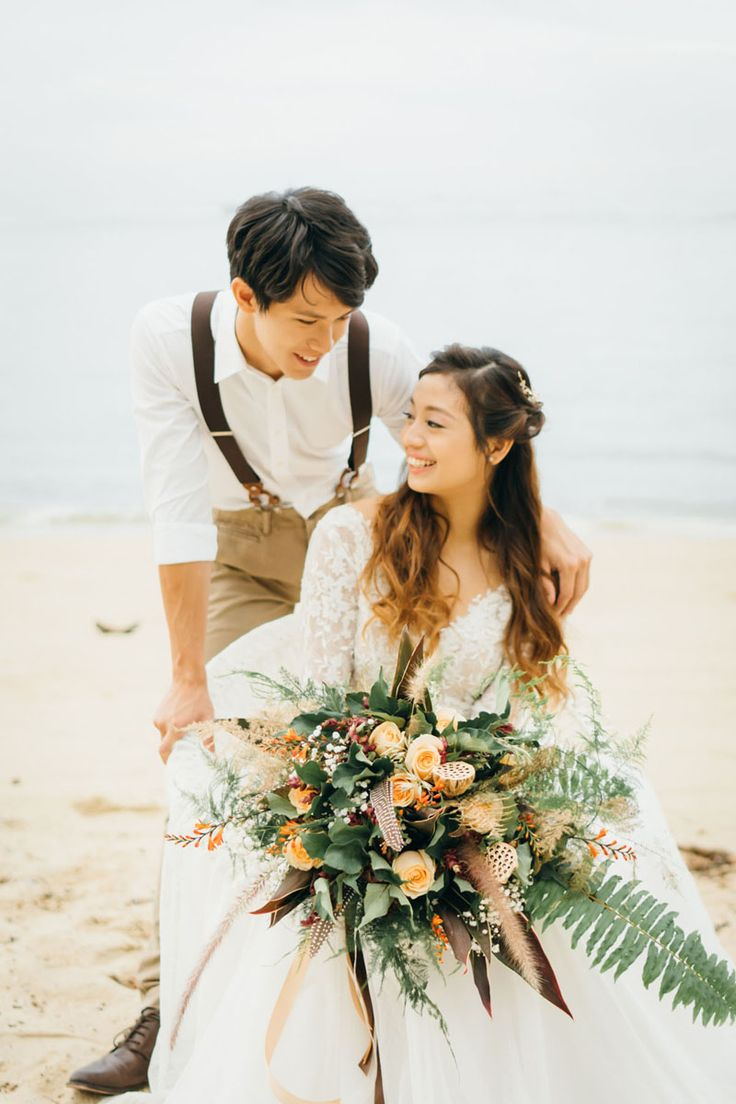 This rusty orange, earthy bridal bouquet is perfect for boho brides! View the full collection on SingaporeBrides.