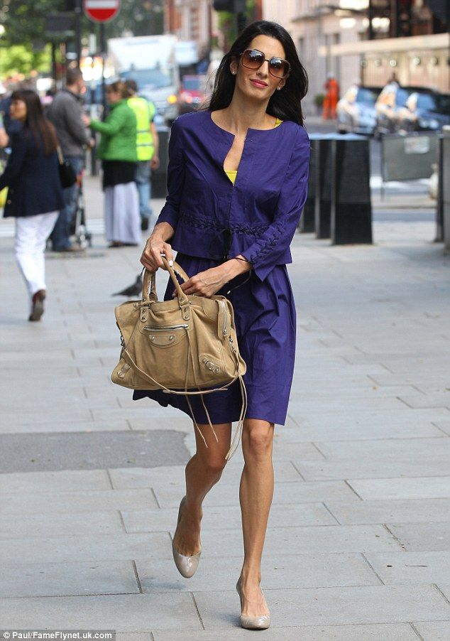 So chic: Amal Alamuddin gets a taxi to the U.S. Embassy wearing a pretty purple jacket and skirt