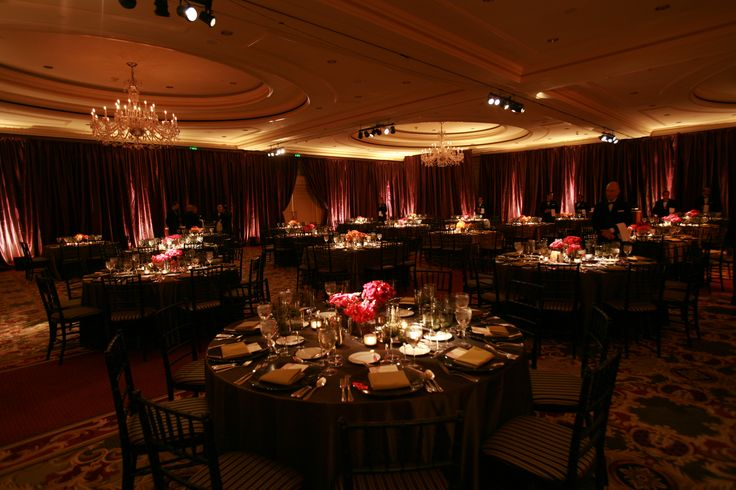 Enhanced Lighting installed Egg Plant Taffeta drapery around the around the perimeter of this Ritz Carlton SF Reception.  Candle lit uplighting and table pinspotting created an inviting environment for the guests.