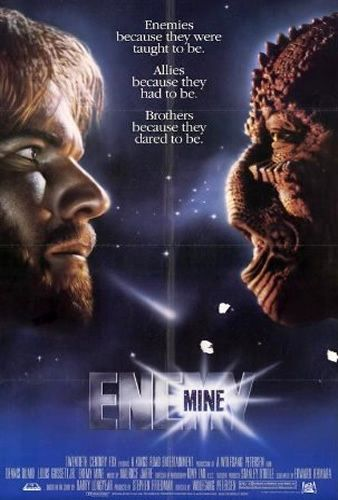 Enemy Mine (1985) - A soldier from Earth crash-lands on an alien world after sustaining battle damage. Eventually he encounters another survivor, but from the enemy species he was fighting; they band together to survive on this hostile world. In the end the human finds himself caring for his enemy in a completely unexpected way.
