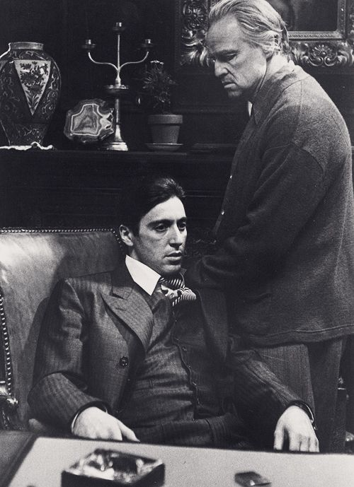 Marlon Brando and Al Pacino as father (Don Vito Corleone) and son (Michael) in The Godfather