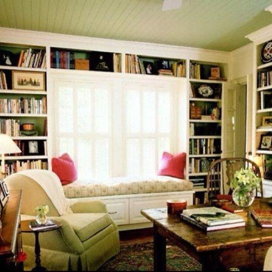 built in bookshelves near windows | built-in shelves around window; window seat | Built In Shelving