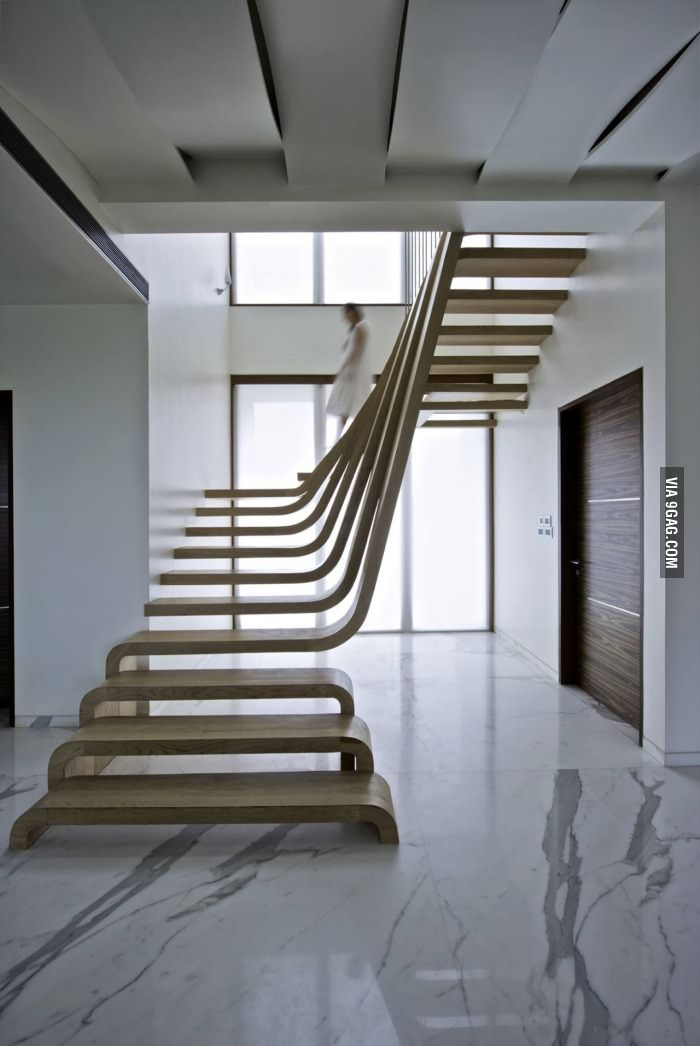 Amazing staircase!! I want one like that in my house some day!!