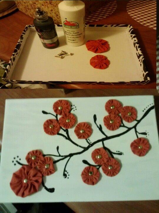 Shoe box cover, white paint, dimensional fabric paint, fabric yo yos, fasteners = ART!