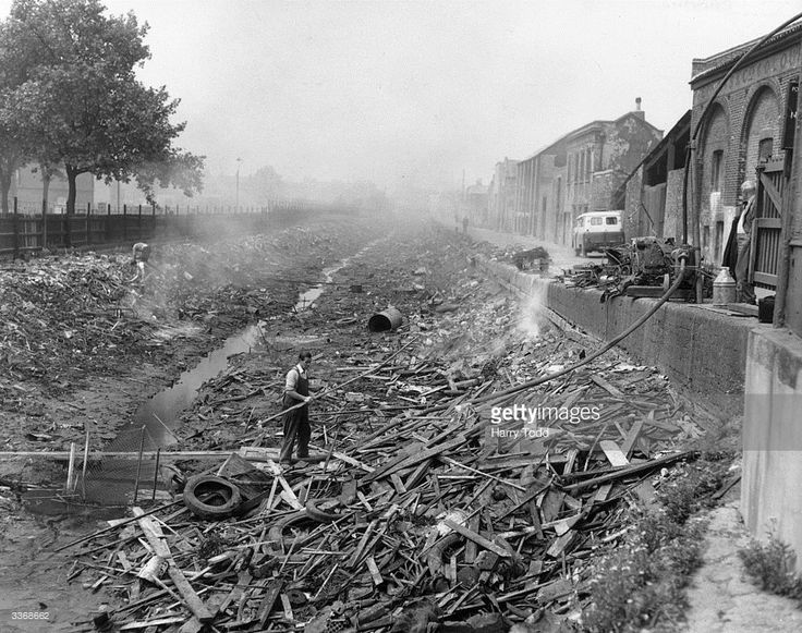 Man clearing drained canal, Grand Surrey Canal, Old Kent Road, South London, 3/6/1960.