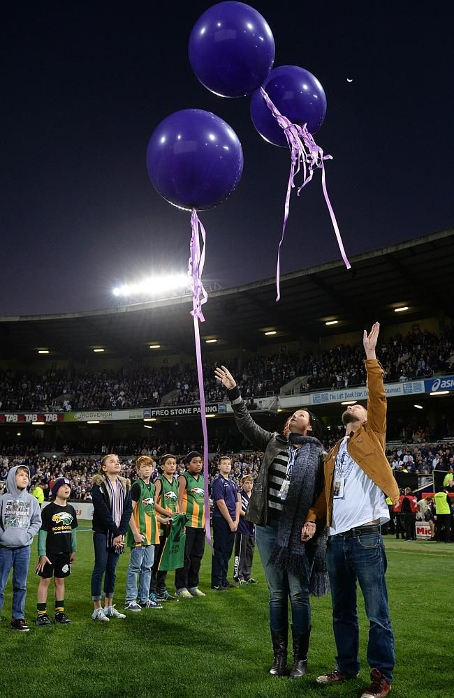 MH 17 TRIBUTE - Rin Norris and Anthony Maslin release balloons for their children Mo, Evie and Otis before the Fremantle vs Carlton clash at Subiaco Oval.