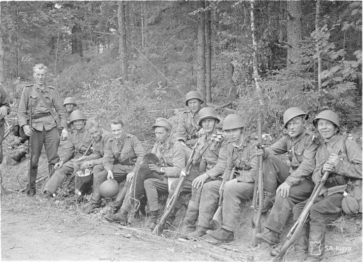 """A group of happy Finnish soldiers after defeating an encircled Soviet """"motti."""" Probably summer 1941. Motti was a Finnish word that originally meant a measure of one cubic metre of firewood. The Finnish army used it to describe their encirclement tactics, first used in the Winter War. They divided the Red Army into """"mottis"""", cutting them off from food and supplies and harassing them until they surrendered."""