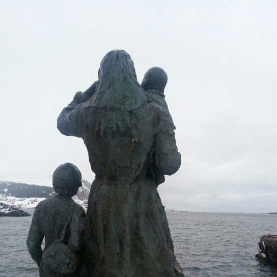Statue in Fosnavåg - norway. The lady and the kids are waiting for their husband and father to come home from sea, but he never showed up. They're Still waiting...