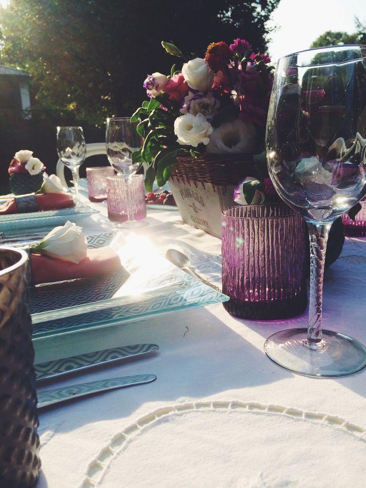 Dinner in the garden. Summer tabletop. Sunlight, fresh flowers, blue tablesetting.