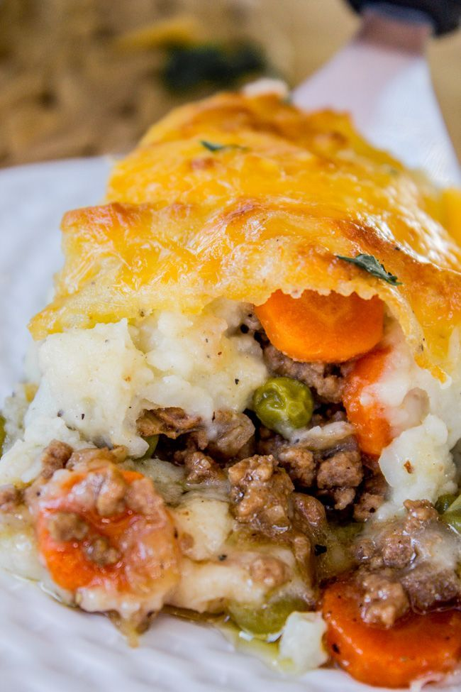 This is not just some filler beef covered with sad wimpy potatoes. This is gravy-soaked beefy goodness, with peas and carrots, covered with yummy mashed potatoes and melted cheddar cheese!!