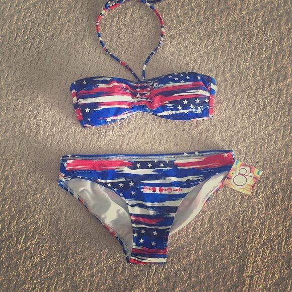 Patriotic Bikini in Red, White and Blue! NWT! Ready for summer! This darling bikini is so cute!!!!  Top doesn't have tags but this has never been worn! OP Swim Bikinis