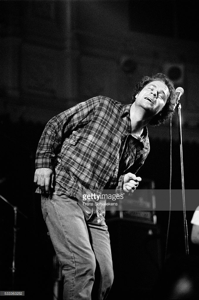 Gordon Downie, guitar and vocals, performs with the Tragically Hip at the Paradiso on February 5th 1993 in Amsterdam, the Netherlands.