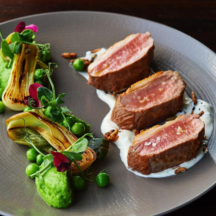 West Country lamb loin with minted yoghurt, spring onion, peas & shoots. A…