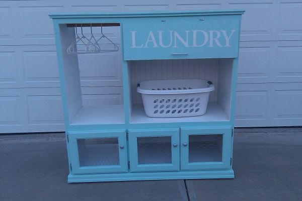 laundry station made out of old entertainment center! I need something like this, or just a bigger laundry room!