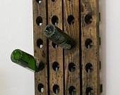 Wine Riddling Rack Distressed Wood Antique Style Winerack. $74.99, via Etsy.