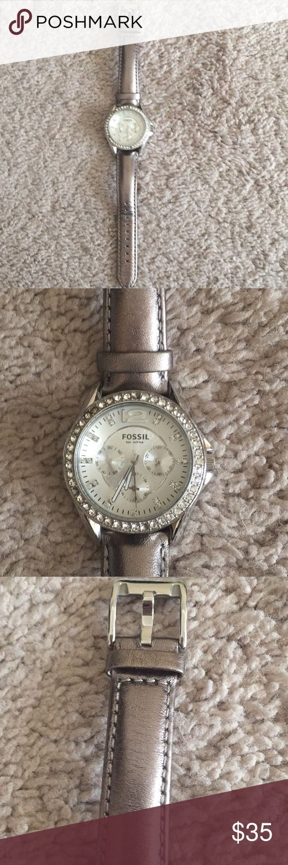 Silver Fossil watch Great condition Fossil watch. Metallic silver genuine leather band. Light silver face with rhinestones surrounding it. Needs a new battery. Accessories Watches