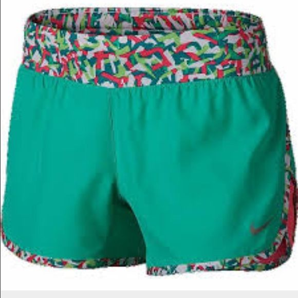NWT Girls Nike DriFit Shorts Brand new girls Nike DriFit Shorts.  These are teal green with pink and white camo trim and insert.  Liner and elastic waste band.  Girls size XS. Nike Shorts