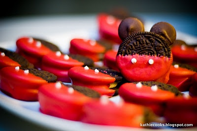 Mickey Mouse oreos. Choc chips, red candy melt and white icing