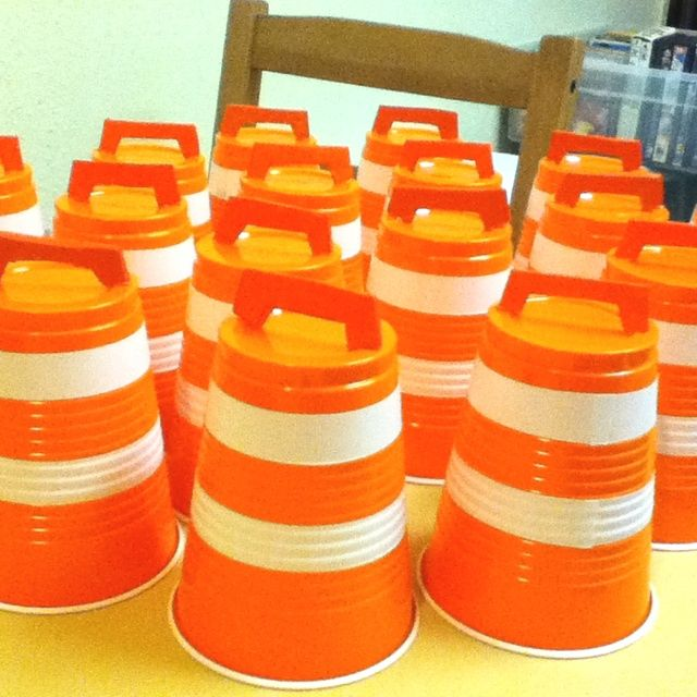 Construction barriers from orange cups, white electrical tape, and orange construction paper.