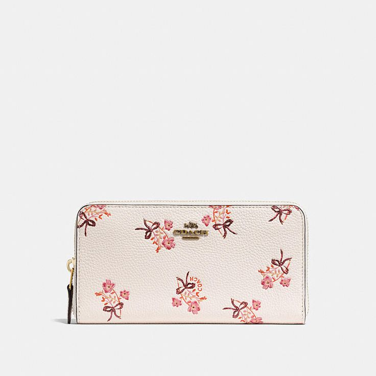 Crafted in polished pebble leather, this wallet fits an iPhone X and features 12 card slots, two full-length bill compartments and a zip coin pocket to keep essentials organized. It's detailed with our Floral Bow print and a hint of glitter.