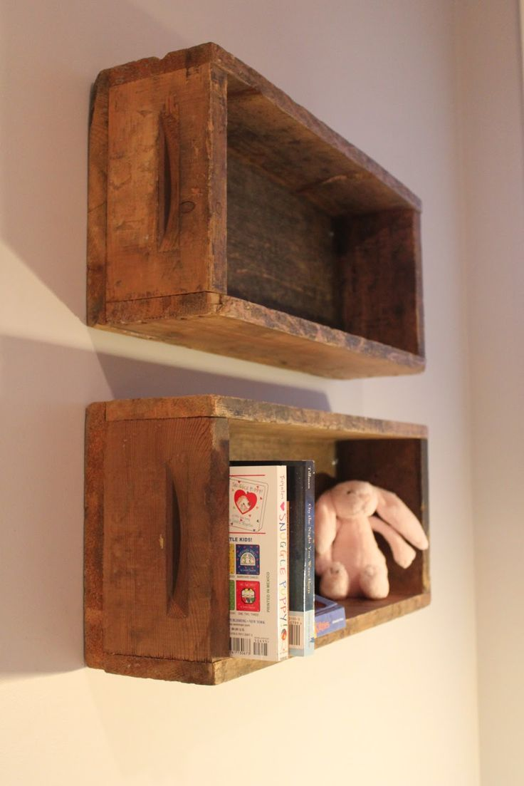 our grey+yellow nursery - old crates used as shelves