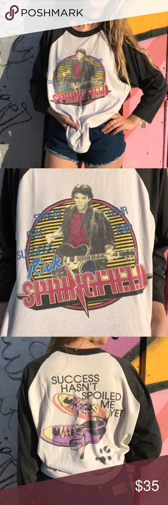 Vintage Rick Springfield 1982 Tour Tee Shirt Awesome Vintage Rick Springfield 1982 Tour Tee Shirt! May be a reprint, but not positive. Looks like it could be original, printing fair just in case it's a reprint. Fits like a L, tag says XL. Enjoy! Shirts Tees - Long Sleeve