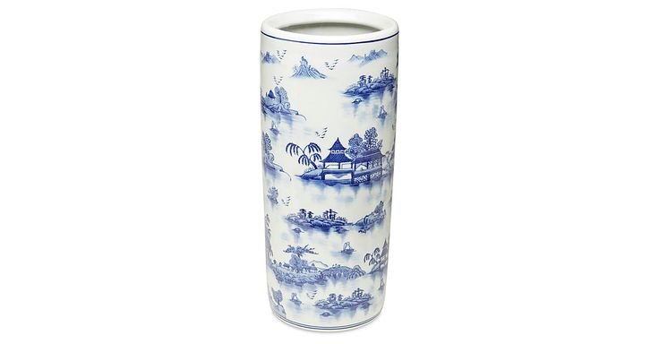 Beautifully crafted of porcelain, this umbrella stand shows off a chinoiserie motifs in blue and white.